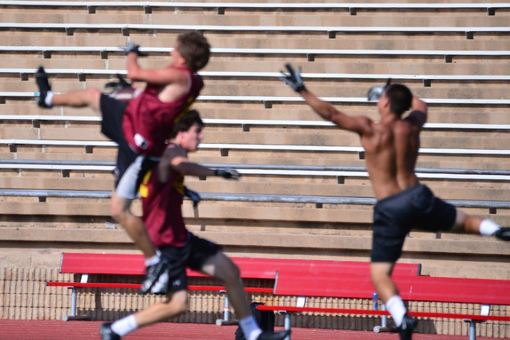 Even out of focus, it is clear that he is making the catch after leaping rather high and pulling it in with one hand.