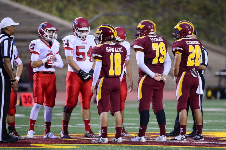 Game Day Captains meet for the coin toss.
