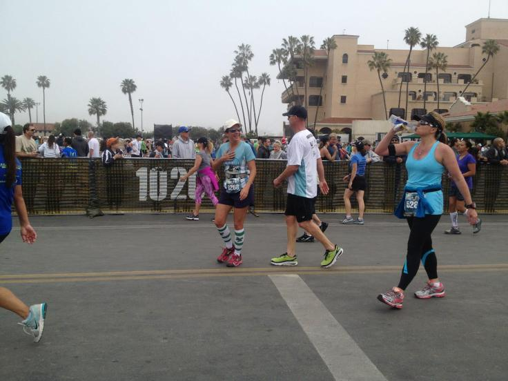 Checking to make sure my heart didn't bail out after crossing the finish line at a dead sprint.