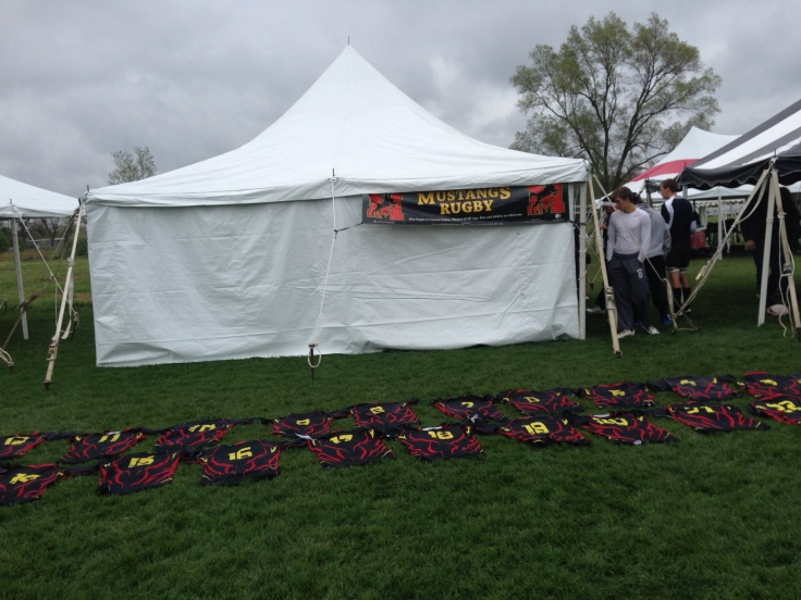 Jerseys lined up outside the Mustang's tent for pre-game handouts.
