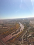 Blurry in flight photo of the Rio Grande as we were landing. The groves of trees on either side were just aflame with fall leaf colors.