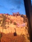 Hard to take clear photos when the tram is moving!  The sun was setting bouncing an orange glow over the canyon walls as we descended creating this shadow image of the tram we were on.